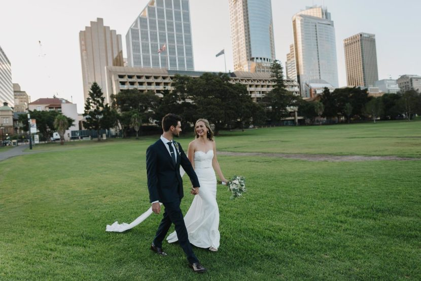 bride-groom-walking-through-sydney-botanical-gardens