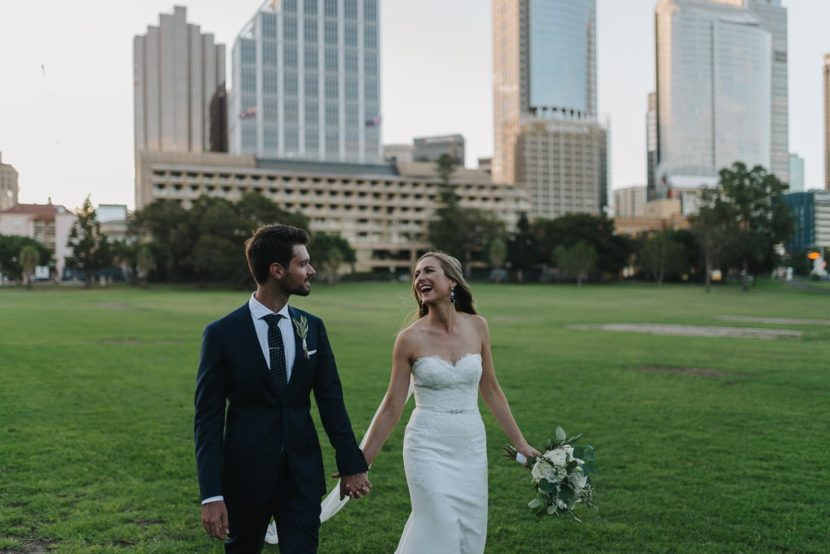 bride-groom-walking-through-sydney-botanical-gardens