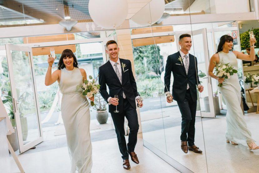 bridal-party-enter-botanical-gardens-restaurant