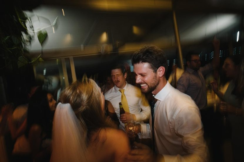 groom-laughing-on-wedding-dance-floor
