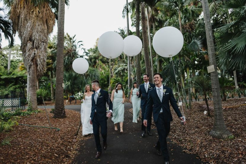 wedding-party-walking-carrying-balloons
