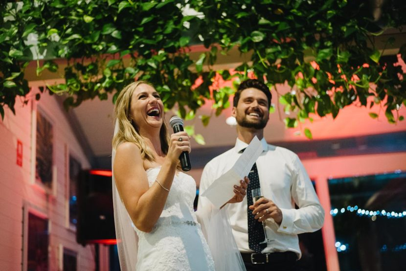 bride-groom-laughing-making-wedding-speech