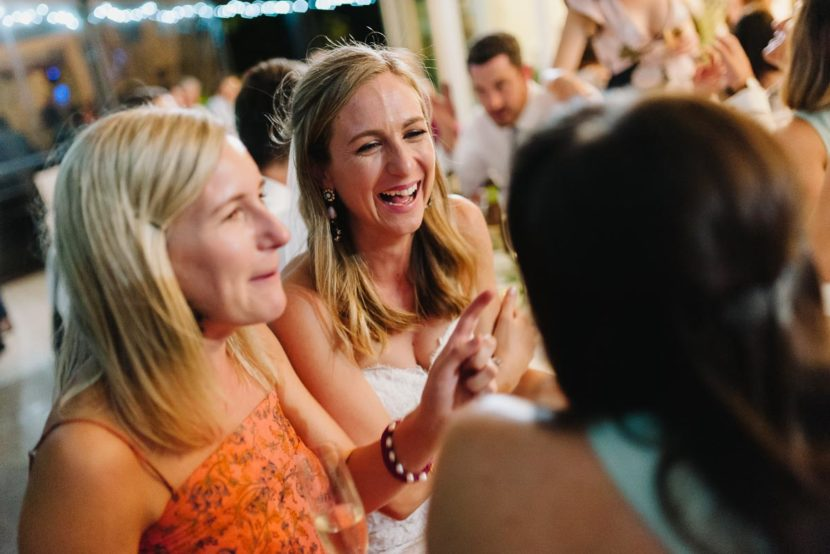 bride-laughing-with-wedding-guests