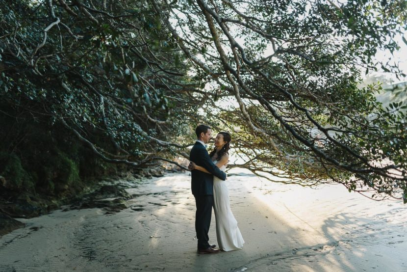 bride-groom-hugging-collins-beach-wedding
