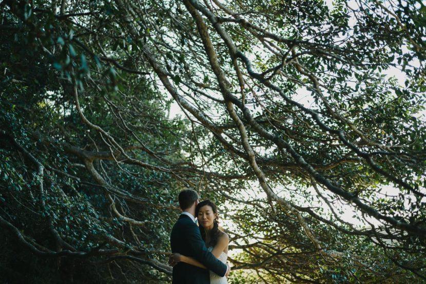 bride-groom-hugging-collins-beach-wedding