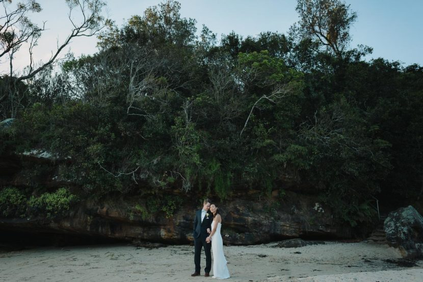 bride-groom-embracing-collins-beach-wedding