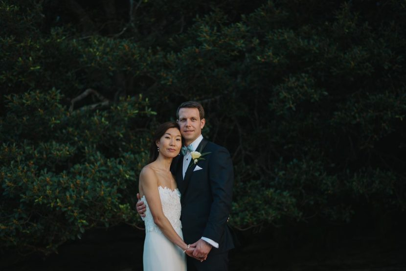 bride-groom-embracing-collins-beach-wedding